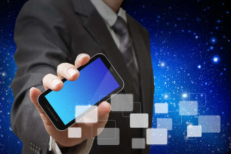 ringtones: touch screen mobile phone in businessman hand
