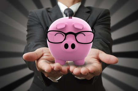 Businessman shows a piggy bank Stock Photo - 12602067