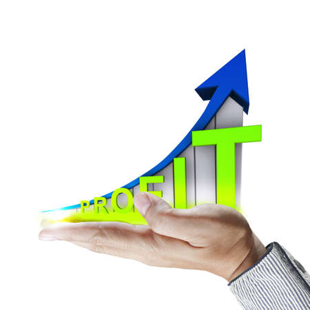 attainment: business hand shows graph grow with profit Stock Photo