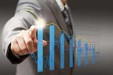 financial graph: businessman hand touch virtual graph,chart, diagram Stock Photo