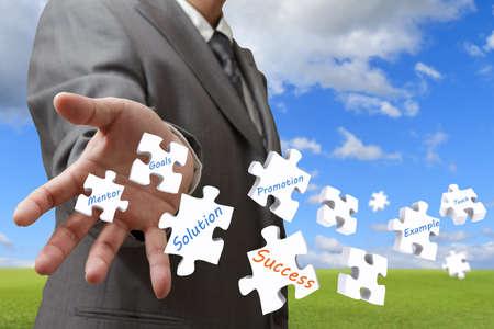 businessman throw puzzles as concept Stock Photo - 12910546