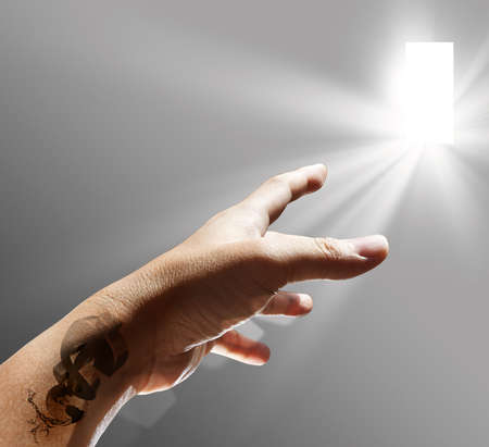hand and dollar tattoo sign reach to the light Stock Photo