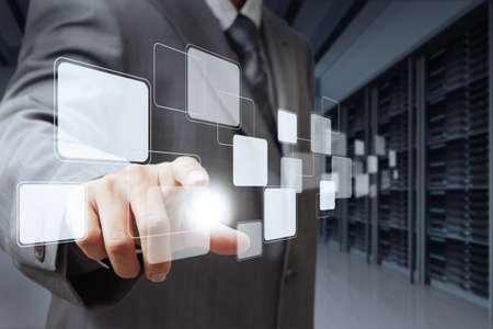 businessman pushing virtual buttons and server room background Stock Photo - 12910549