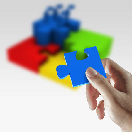 Success concept,puzzles in hand Stock Photo - 12909909
