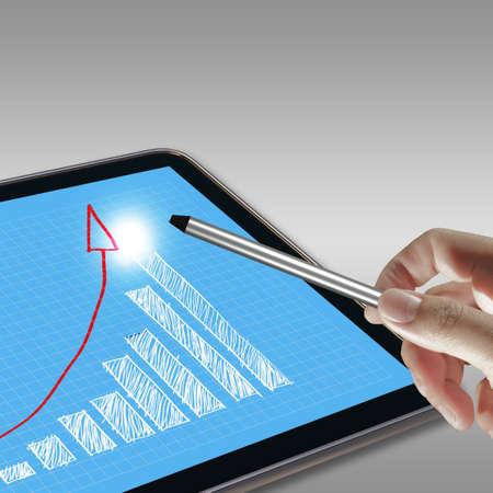 pointing graph on computer pad photo