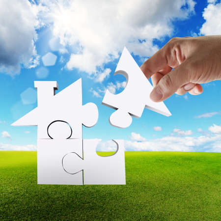 hand complete puzzle home as concept Stock Photo - 12910663