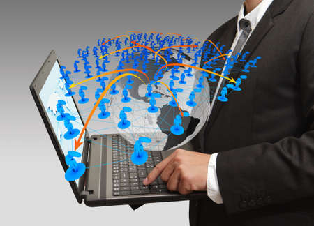 business man pressing computer laptop and social network photo