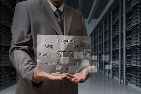 back link: business man hand shows virtual screen of SEO diagram