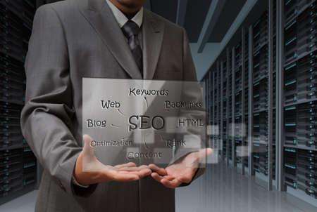 business man hand shows virtual screen of SEO diagram Stock Photo - 13106823