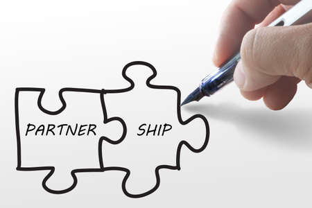 hand draw puzzles and partner ship on paper Stock Photo - 13106489