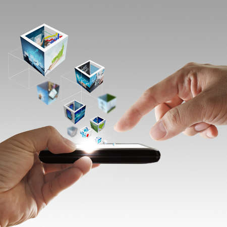 mobile phone in hand streaming 3d images Stock Photo - 13106989
