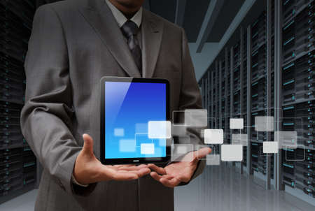 business man and tablet computer in server room Stock Photo - 13106820