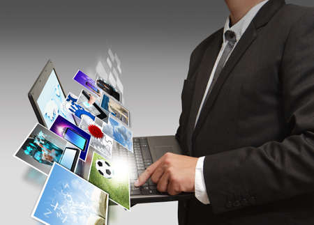 Business man holding his laptop Stock Photo - 13106832