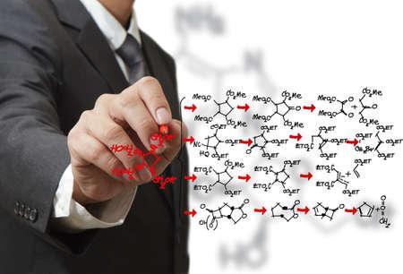 chemist draws a molecular structure photo
