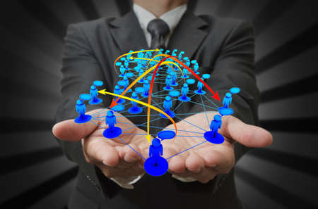 Businessman hand holds social network Stock Photo - 13181475