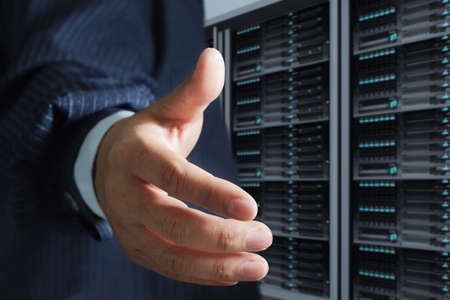 business man offers handshake in server room Stock Photo - 13181502