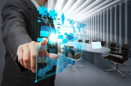 virtual world: businessman hand point on virtual business network in board room