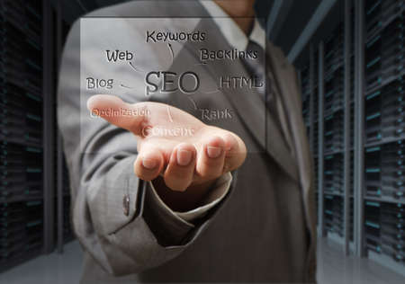 engine room: business man show seo diagram shield in server room Stock Photo