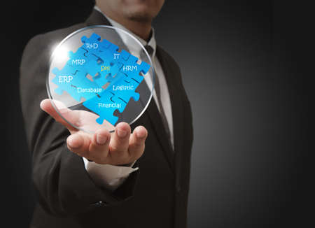 business man shows business puzzles with glass shield Stock Photo - 13181187