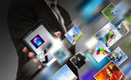 business hand shows touch screen mobile phone with streaming images photo