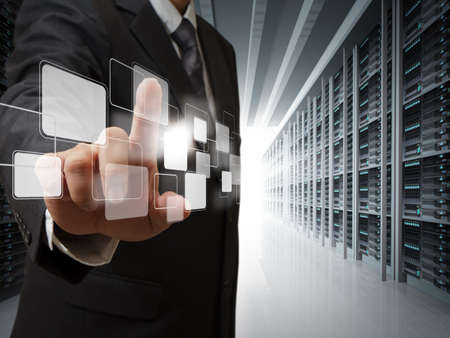 service providers: business man point virtual buttons in server room