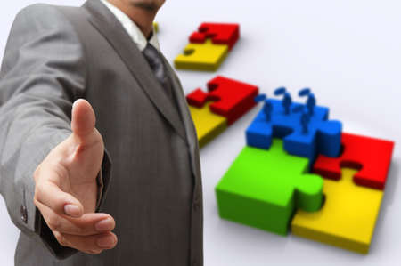 business man hand shows puzzles of success photo