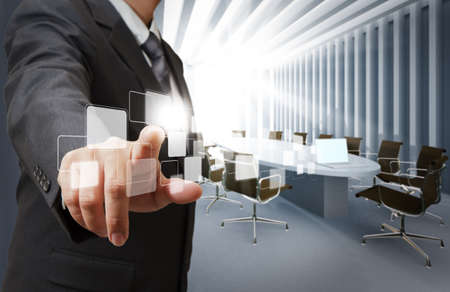 touch technology: business man point virtual buttons in board room