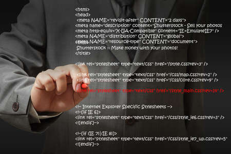 html: Businessman Highlighting Website Script Stock Photo