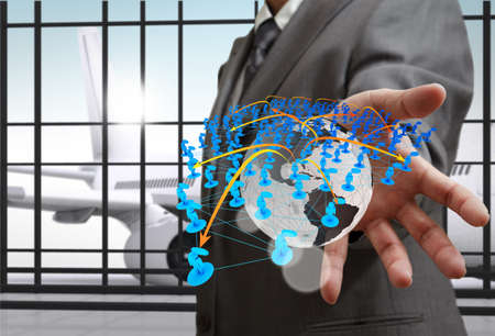globe in hand: business man hand shows social network icons as concept