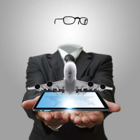 invisible business man shows tablet computer with aircraft as concept photo