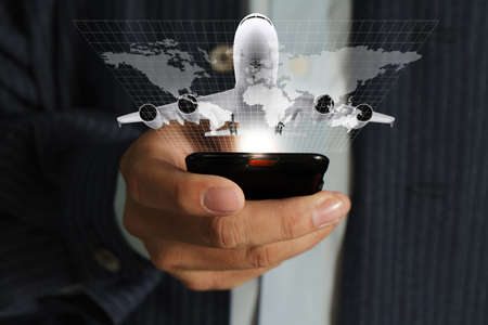 travel map: business man hand use mobile phone streaming travel around the world Stock Photo