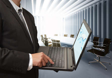 business man using laptop computer in board room photo