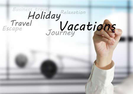sensational: female hand draws vacations theme Stock Photo
