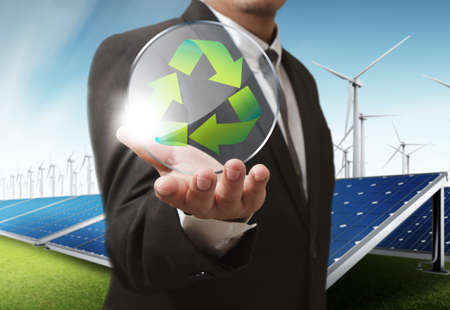 corporate responsibility: businesss man shows recycle glass shield as concept