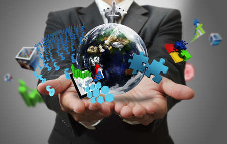 solutions icon: business man hand shows the world of business as concept Elements of this image furnished by NASA