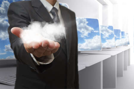 cloud computing concept: business man hand shows cloud network concept Stock Photo