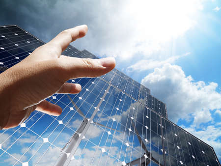hand reach the sun concept renewable, alternative solar energy, sun-power plant Stock Photo