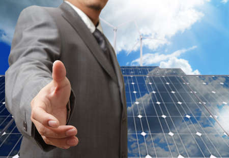 business man offers handshake with green business concept