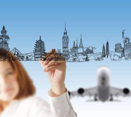 female hand draws dream travel photo