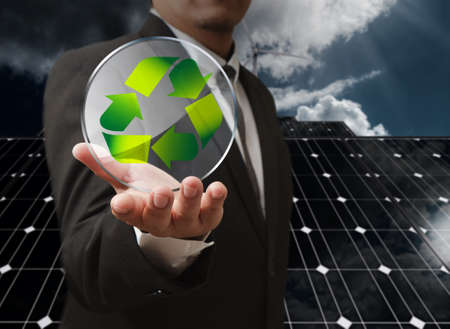 corporate responsibility: business man hand shows recycle glass shield as concept