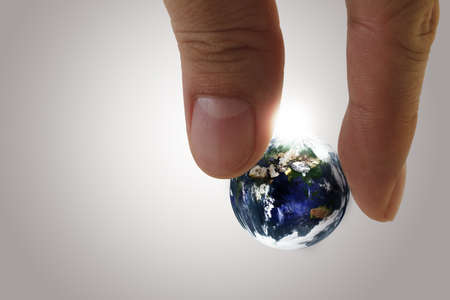 globe in fingers Elements of this image furnished by NASA  photo