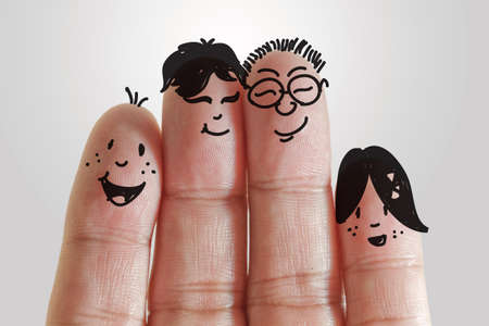happy family with painted smiley on human fingers photo
