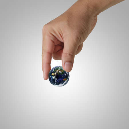 hand pick the earth Elements of this image furnished by NASA Stock Photo - 13310135