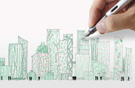 office environment: hand draws green city as concept design