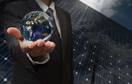 business man hand shows the earth as green energy concept  Elements of this image furnished by NASA photo