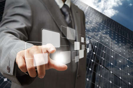 business man hand point to virtual buttons as green energy concept photo