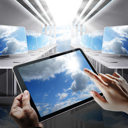 technology agreement: hand holds tablet computer as cloud network concept Stock Photo