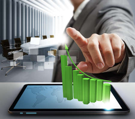 business man hand point to virtual graph with tablet computer Stock Photo - 13310316