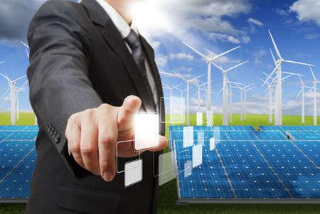 eficiencia energetica: hombre de negocios punto a mano en blanco botones virtuales
