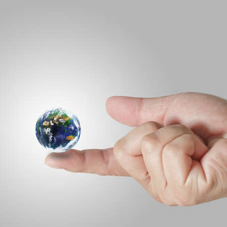 earth globe on his finger Elements of this image furnished by NASA  Stock Photo - 13310116